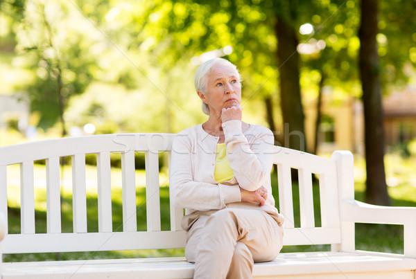 Szomorú idős nő ül pad nyár Stock fotó © dolgachov