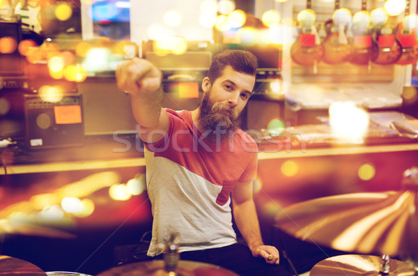 male musician playing drum kit at music store Stock photo © dolgachov