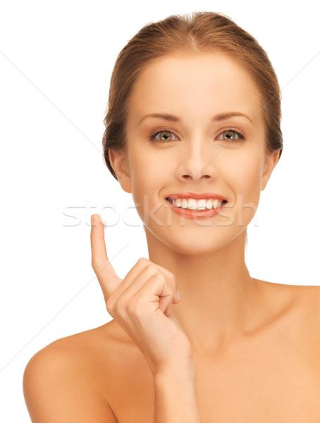 beautiful woman with moisturizing creme drop Stock photo © dolgachov