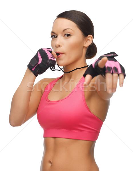 woman with whistle Stock photo © dolgachov
