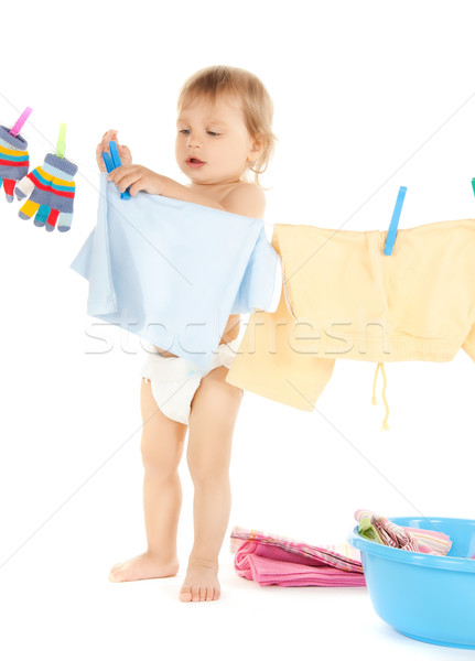 baby doing laundry Stock photo © dolgachov
