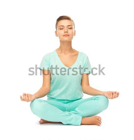 Fată şedinţei lotus pozitie meditativ imagine Imagine de stoc © dolgachov