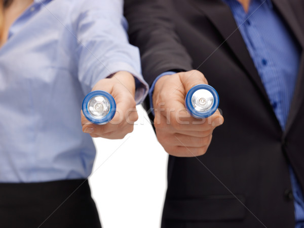 business team holding pocket flashlights Stock photo © dolgachov