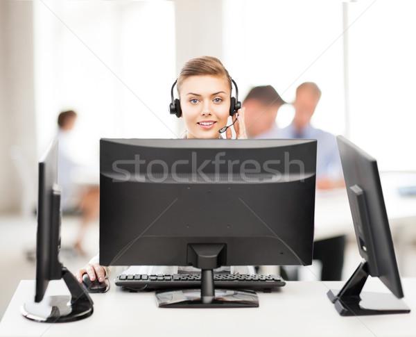 Barátságos női segélyvonal kezelő fejhallgató ügyfélszolgálat Stock fotó © dolgachov