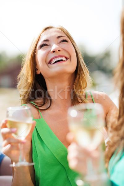 girl with champagne glass Stock photo © dolgachov