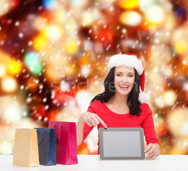 woman in santa helper hat with tablet pc Stock photo © dolgachov