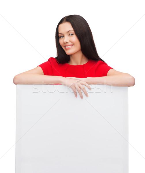 Mosolyog fiatal nő fehér tábla emberek nő lány Stock fotó © dolgachov
