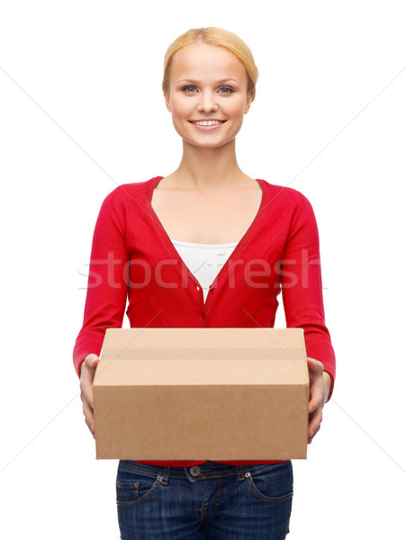 smiling woman in casual clothes with parcel box Stock photo © dolgachov
