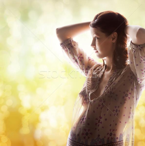 Silhouette foto incinta bella donna famiglia maternità Foto d'archivio © dolgachov