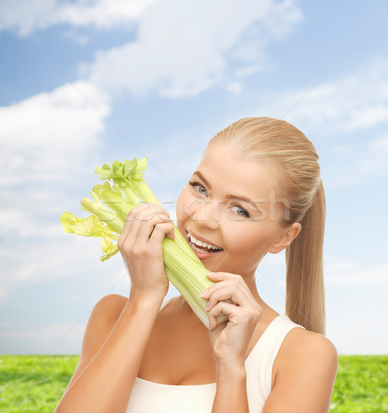 woman biting piece of celery or green salad Stock photo © dolgachov