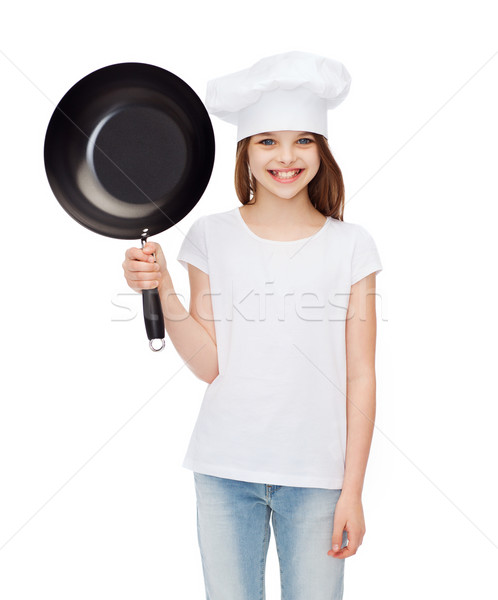 smiling girl in cook hat with frying pan Stock photo © dolgachov