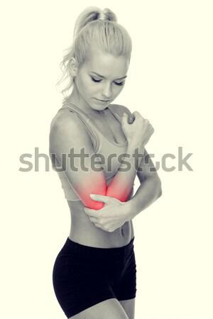 женщину более локоть здравоохранения фитнес Сток-фото © dolgachov