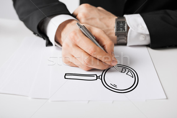 close up of male hands with pen drawing lens Stock photo © dolgachov