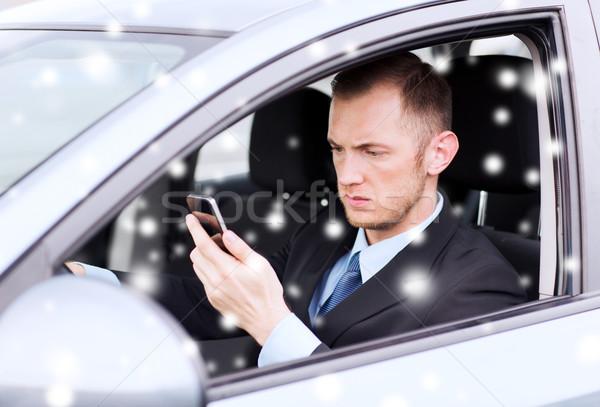 close up of man using smartphone while driving car Stock photo © dolgachov