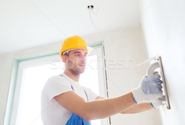 builder with grinding tool indoors Stock photo © dolgachov
