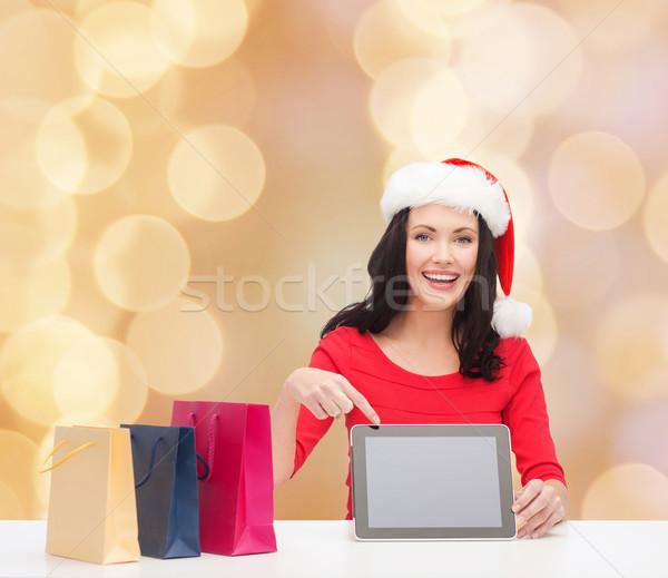 Stock fotó: Mosolygó · nő · mikulás · kalap · szatyrok · táblagép · karácsony