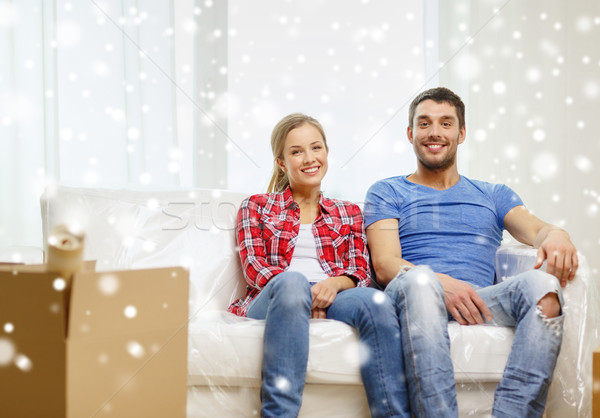 Gülen çift rahatlatıcı kanepe yeni ev tamir Stok fotoğraf © dolgachov