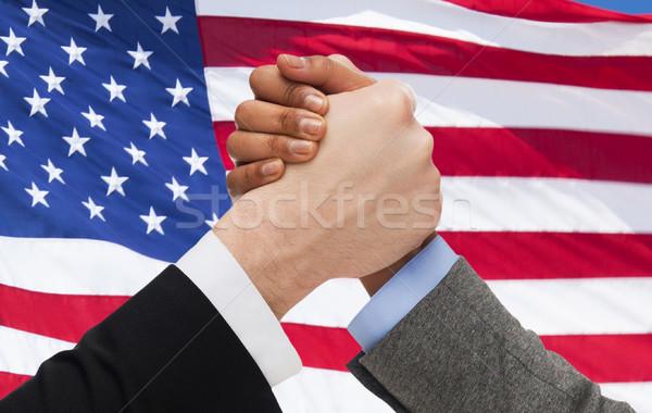 Handen arm worstelen Amerikaanse vlag politiek Stockfoto © dolgachov