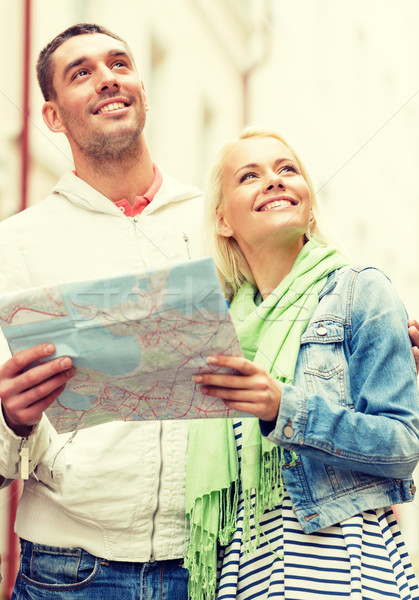 happy couple with map exploring city Stock photo © dolgachov