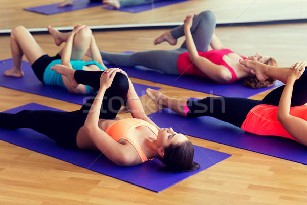 group of women stretching in gym Stock photo © dolgachov