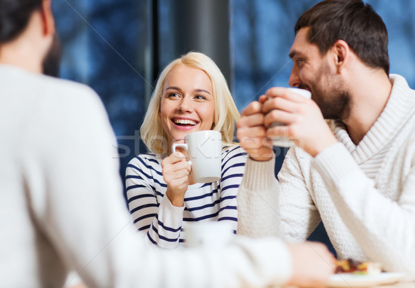 happy friends meeting and drinking tea or coffee Stock photo © dolgachov
