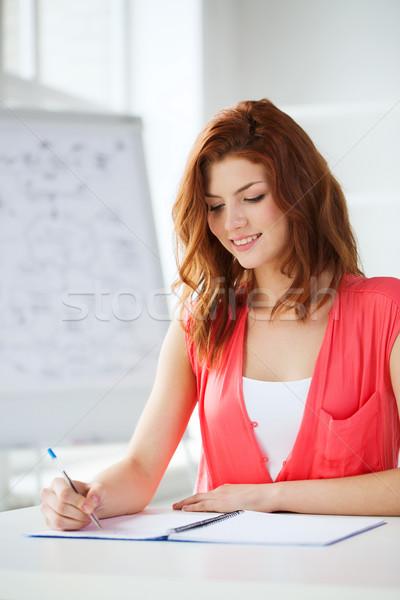 Stock fotó: Mosolyog · diák · tankönyvek · iskola · oktatás · tankönyv