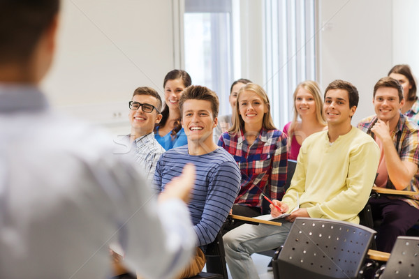group of students and teacher with notebook Stock photo © dolgachov