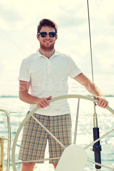 Młody człowiek okulary kierownica jacht wakacje wakacje Zdjęcia stock © dolgachov