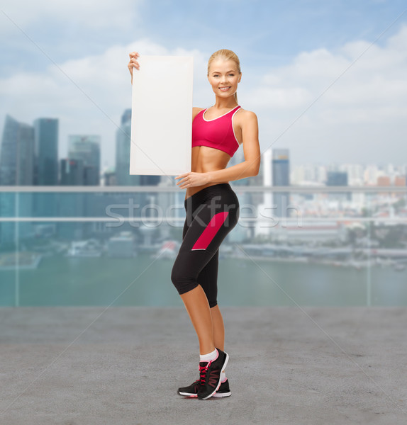 sportswoman with white blank board Stock photo © dolgachov