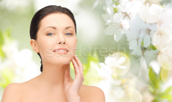 beautiful young woman touching her face Stock photo © dolgachov