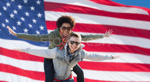 happy multiracial couple over american flag Stock photo © dolgachov