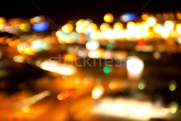 golden bright lights on dark night background Stock photo © dolgachov