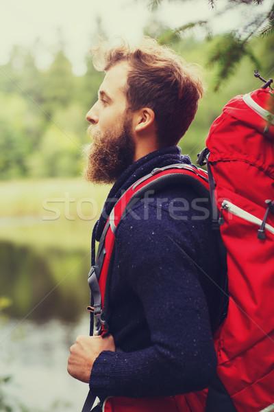 smiling man with beard and backpack hiking Stock photo © dolgachov