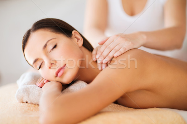 beautiful woman in spa having massage Stock photo © dolgachov