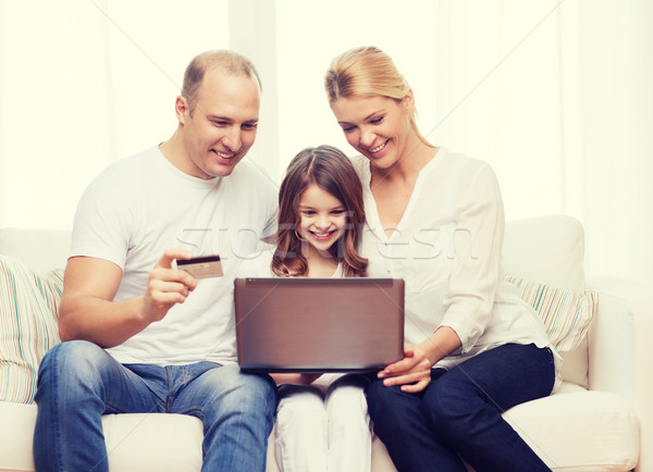 parents and girl with laptop and credit card Stock photo © dolgachov