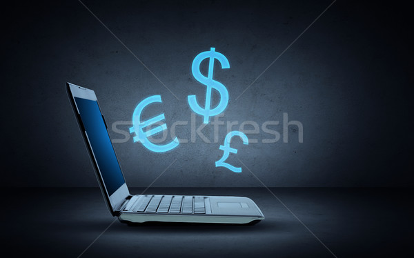 Laptop computer verlichting valuta symbolen technologie Stockfoto © dolgachov