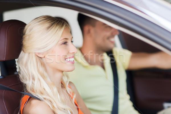 happy man and woman driving car Stock photo © dolgachov