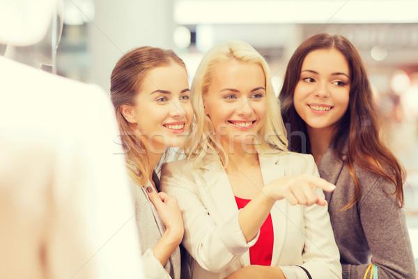 幸せ 若い女性 ショッピングバッグ モール 販売 ストックフォト © dolgachov