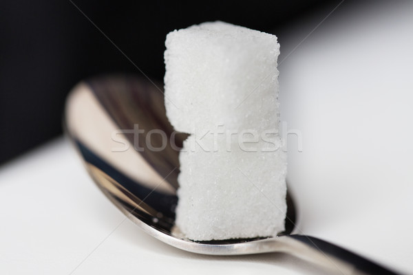 Stock photo: close up of white sugar cubes on teaspoon