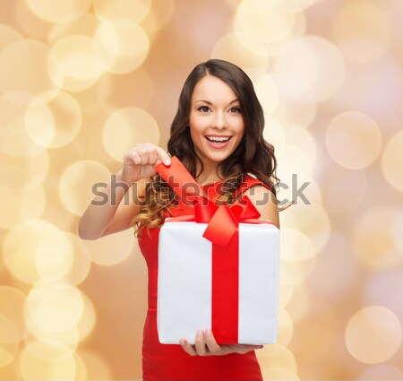 happy woman in red dress with gift over firework Stock photo © dolgachov