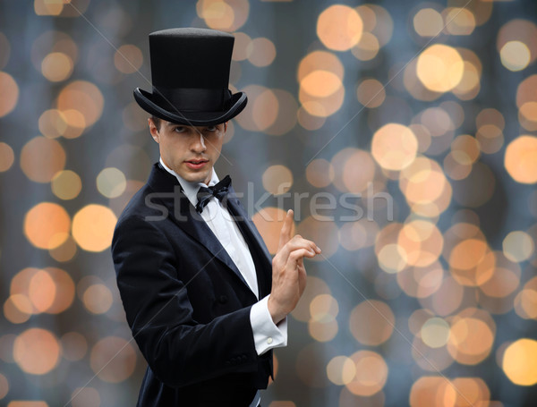 magician in top hat pointing finger up Stock photo © dolgachov