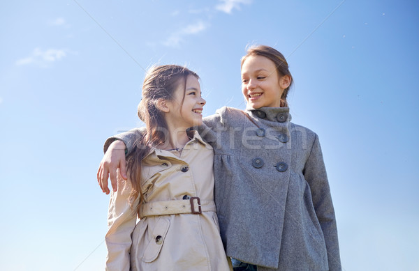 happy little girls hugging and talking outdoors Stock photo © dolgachov