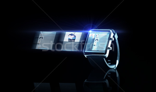 close up of black smart watch with web page Stock photo © dolgachov