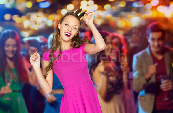 happy young woman in princess crown at night club Stock photo © dolgachov