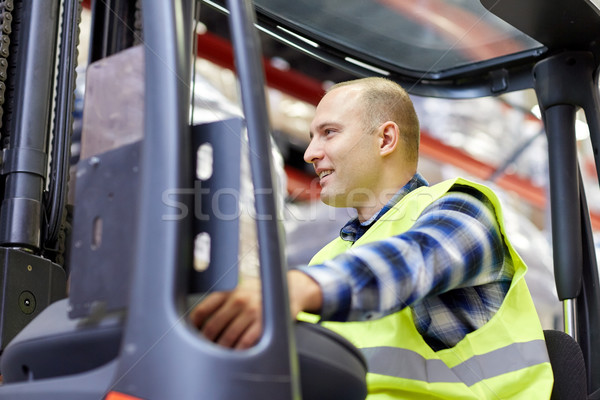 man operating forklift loader at warehouse Stock photo © dolgachov