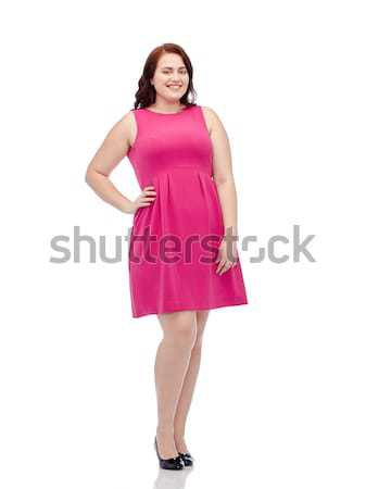 happy young plus size woman posing in pink dress Stock photo © dolgachov