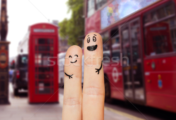 close up of two fingers with smiley faces Stock photo © dolgachov