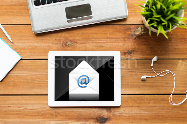 close up of tablet pc computer on wooden table Stock photo © dolgachov