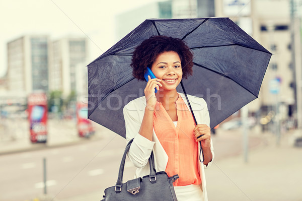 Işkadını şemsiye çağrı iş kötü hava Stok fotoğraf © dolgachov