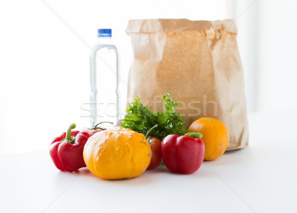 close up of paper bag with vegetables and water Stock photo © dolgachov